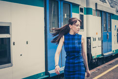 Pretty girl walking along the tracks Stock Photography