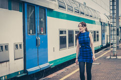 Pretty girl walking along the tracks Stock Photo