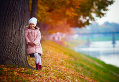 Pretty girl walking in autumn park among fallen leaves Stock Photography
