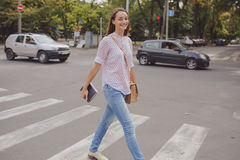 Pretty girl is walking in the city Stock Photography