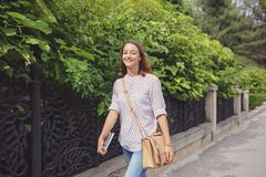 Pretty girl is walking in the city Royalty Free Stock Photography