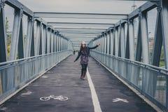 Pretty girl walking happy on a bridge Royalty Free Stock Photos