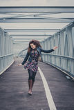 Pretty girl walking happy on a bridge Stock Photography