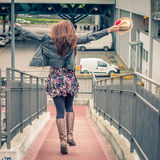 Pretty girl walking happy on railroad bridge. Pretty girl with long hair walking happy on railroad bridge Royalty Free Stock Photos