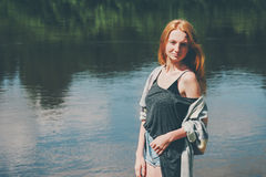 Pretty girl walking at river Lifestyle summer stock photography