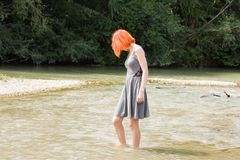 Pretty girl walking in river Royalty Free Stock Photography