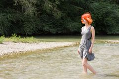Pretty girl walking in river Stock Images