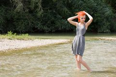 Pretty girl walking in river Royalty Free Stock Images