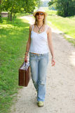 Pretty girl walking on the road Stock Photography