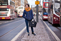 Pretty girl walking on the road Royalty Free Stock Photo