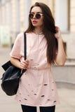 Pretty girl walking the street Stock Photos
