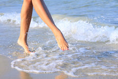 Pretty girl walking in water Stock Photography