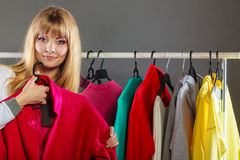 Pretty girl watching new clothes. Royalty Free Stock Images