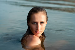 Pretty girl in water Stock Images