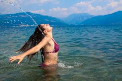 Pretty girl in water hair splashing Royalty Free Stock Image