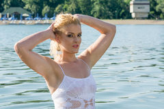 Pretty girl in water looks into the camera Royalty Free Stock Images
