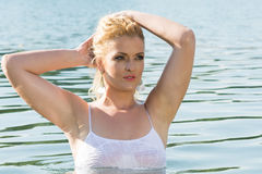 Pretty girl in water looks into the distance Royalty Free Stock Photos