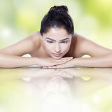 Pretty girl with water reflection after skincare Royalty Free Stock Photos