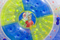 Pretty girl in water-roller Royalty Free Stock Image