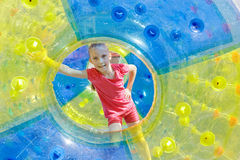 Pretty girl in water-roller Stock Images