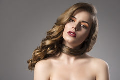 Pretty girl with wavy hair on shoulder and sensual Stock Photos