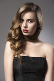 Pretty girl with wavy hair on shoulder and sensual Royalty Free Stock Image