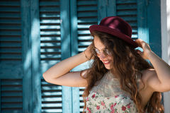 Pretty girl wear sunglasses and red bowler hat Stock Photos