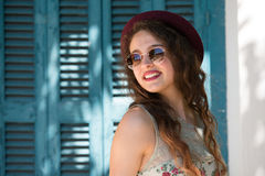 Pretty girl wear sunglasses and red bowler hat Royalty Free Stock Photo