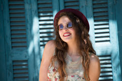 Pretty girl wear sunglasses and red bowler hat Stock Photography