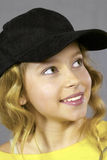 Pretty girl wearing a baseball cap Royalty Free Stock Photography
