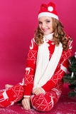Pretty girl is wearing christmas hat and pajamas Stock Photos