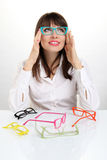 Pretty girl wearing colored glasses Stock Images