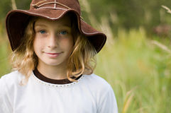 Pretty girl wearing a floppy sunhat. Tween aged girl wearing a floppy brown sunhat outdoors Royalty Free Stock Photography