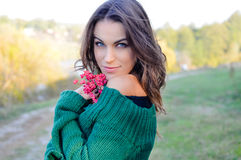 Pretty girl wearing green sweater holding pink Stock Photo