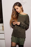 Pretty girl wearing green sweatshirt Stock Images