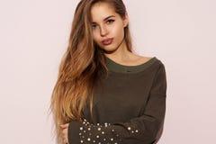 Pretty girl wearing green sweatshirt Royalty Free Stock Photography