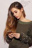 Pretty girl wearing green sweatshirt Stock Photos