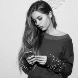 Pretty girl wearing green sweatshirt Royalty Free Stock Image