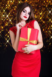 Pretty girl is wearing red dress with gift box royalty free stock photos