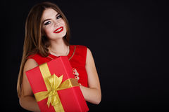 Pretty girl is wearing red dress with gift box Stock Photo