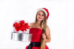Pretty girl wearing red dress holding present gift box isolated on white Stock Photography