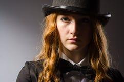 Pretty girl wearing retro hat  on gray Stock Image