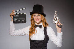 Pretty girl wearing retro hat  on gray Stock Images