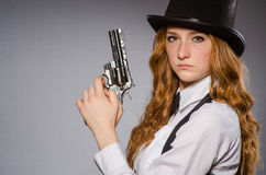 Pretty girl wearing retro hat and holding weapon Stock Photo