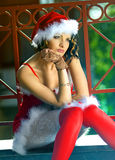 Pretty girl wearing santa claus clothes Stock Photography
