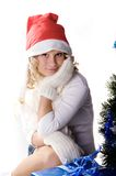 Pretty girl wearing santa hat. Pretty girl wearing knitted mittens and santa hat Stock Photos