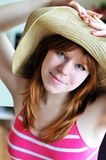 Pretty girl wearing straw hat Stock Photo