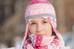 Pretty girl wearing warm hat and scarf Royalty Free Stock Images