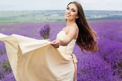 Pretty girl is wearing wedding dress at purple Stock Photo