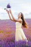 Pretty girl is wearing wedding dress at purple Stock Photo